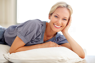 Buy stock photo Beautiful young woman smiling while lying on the floor indoors