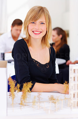 Buy stock photo Cropped shot of a young architect working on a new building plan