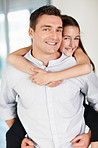 Cheerful little girl enjoying piggyback ride with her father