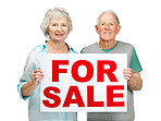 Sweet elderly couple holding sale sign