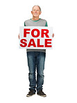 Retired old man holding sale sign on white