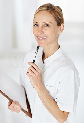 Female nurse in uniform with a notepad and pen