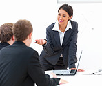 Happy female speaker conducting a business meeting