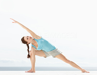 Cute young lady practicing yoga