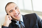 Happy middle aged business man talking over the telephone