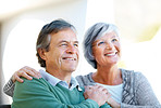 Happy elderly couple looking at copyspace