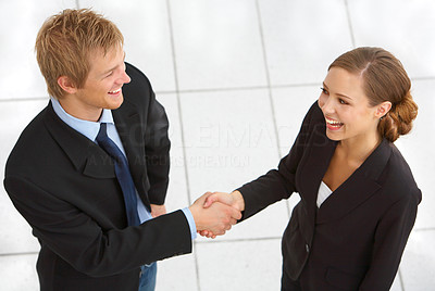 Buy stock photo Cropped shot of two businesspeople shaking hands