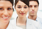 Smiling business woman standing in line with colleagues
