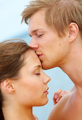 Buy stock photo A young couple kissing The concept is: Summer love, romance and a happy lifestyle.
