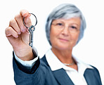 Elderly woman handing you a key isolated on white