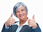 Smiling elderly business woman showing a success sign on white