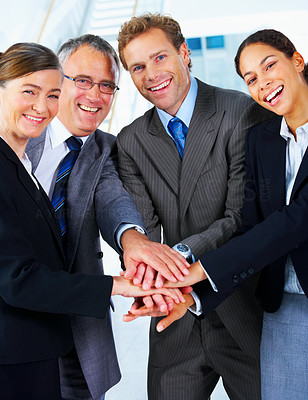Buy stock photo Handshake and teamwork. A group of business people making a pile of hands in a light and modern office environmenta