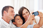 Family taking self portrait at home