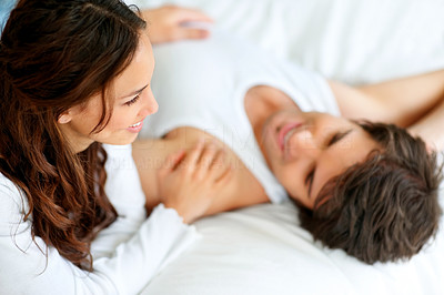 Happy young couple relaxing on the bed