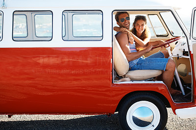 Buy stock photo Portrait of young loving couple sitting in their mini van on a road trip - copyspace
