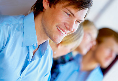 Buy stock photo A young, confident man in front of a creative workgroup.
