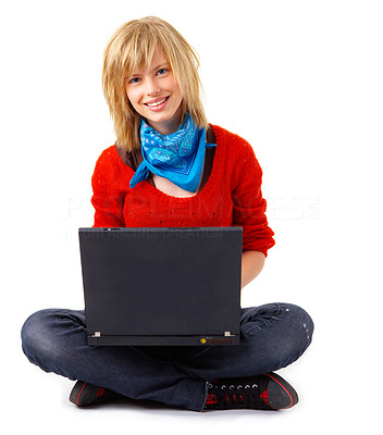 Buy stock photo A studio shoot of a beautiful young girl sitting with a computer in her lap.
