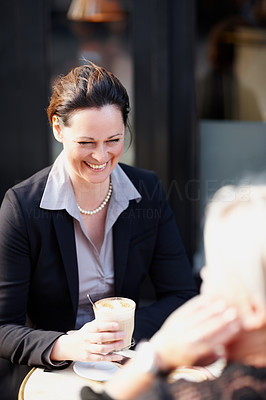 Business woman having coffee in an outdoor restaurant