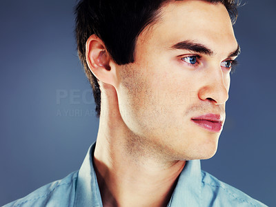 Buy stock photo Closeup portrait of a handsome young man thinking against grey background
