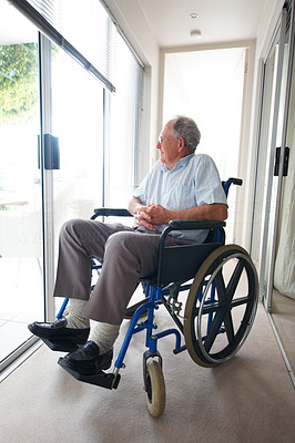Handicapped elderly man sitting in a hospital