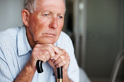 Closeup of a sad elderly man lost in thought