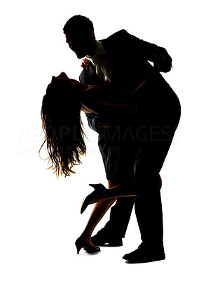 Buy stock photo Portrait of a beautiful young couple dancing with each other against white background