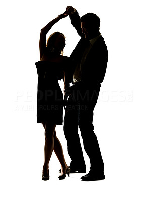 Buy stock photo Portrait of a lovely young couple dancing together against white background