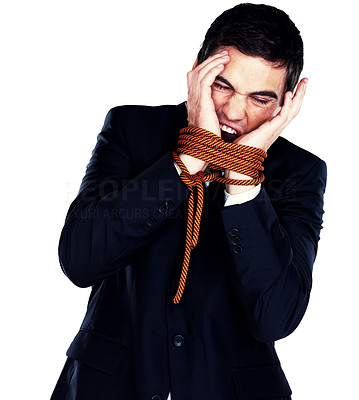 Buy stock photo Frustrated young businessman trying to free his hands of the rope tying them together, isolated on white background