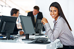 Successful young businesswoman at her office gesk