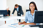 Smiling young business woman at office desk