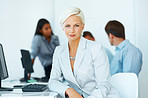 Confident young businesswoman sitting in office
