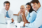 Portrait of multi ethnic business team in a meeting