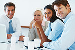 Happy team of business associates at a meeting