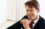 Successful young businessman smiling - Copyspace