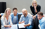 Portrait of smiling business people in a meeting