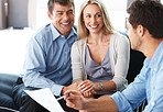 Expert advice - Smiling young couple listening to male consultant