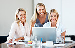 Smiling business women at meeting in office