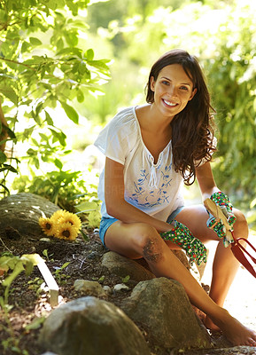 Buy stock photo Portrait of young female gardner relaxing holding a rake and trowel - Outdoor