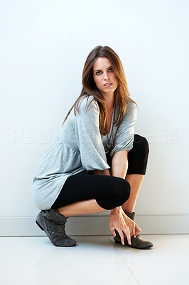 Buy stock photo Gorgeous young female model posing against white b