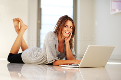 Buy stock photo Pretty happy young woman with a laptop on floor