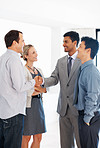Business team shaking hands in office lobby