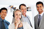 Business woman in headphones smiling with office colleagues