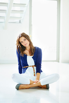 Buy stock photo Pretty happy young lady sitting on floor