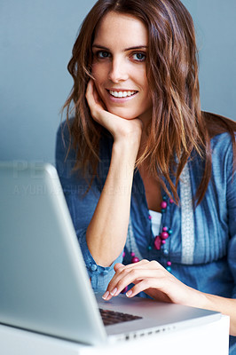 Buy stock photo Charming young woman working on laptop