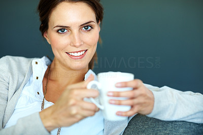 Buy stock photo Beautiful young woman holding a cup of coffee