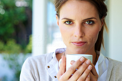 Buy stock photo Lovely young woman having a cup of coffee