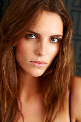 Buy stock photo Closeup portrait of an attractive young woman looking at the camera