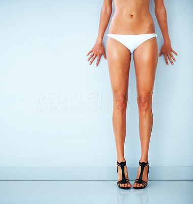 Buy stock photo Cropped image of a sexy woman standing in white cotton panties and designer shoes against a blank wall - copyspace