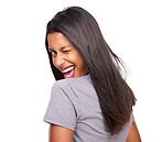 Happy woman looking back with a naughty wink