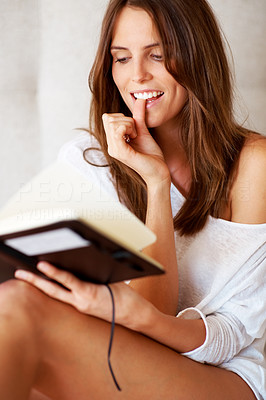 Buy stock photo Sexy young woman reading a diary